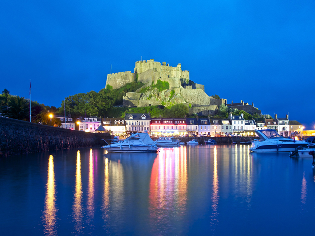 Night view of Mont Orgueil Castle just along the coast from Beausite Apartments